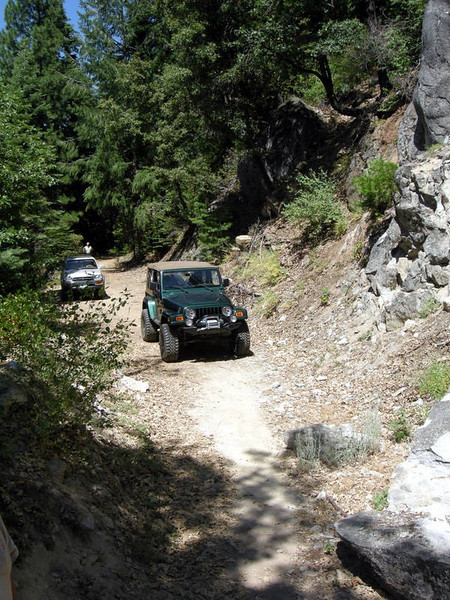 Planning to find a cache at an old trestle, our first route deadends.<br /> <br /> A giant new rockfall blocks the road