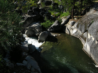 River and cascades near an old bridge.