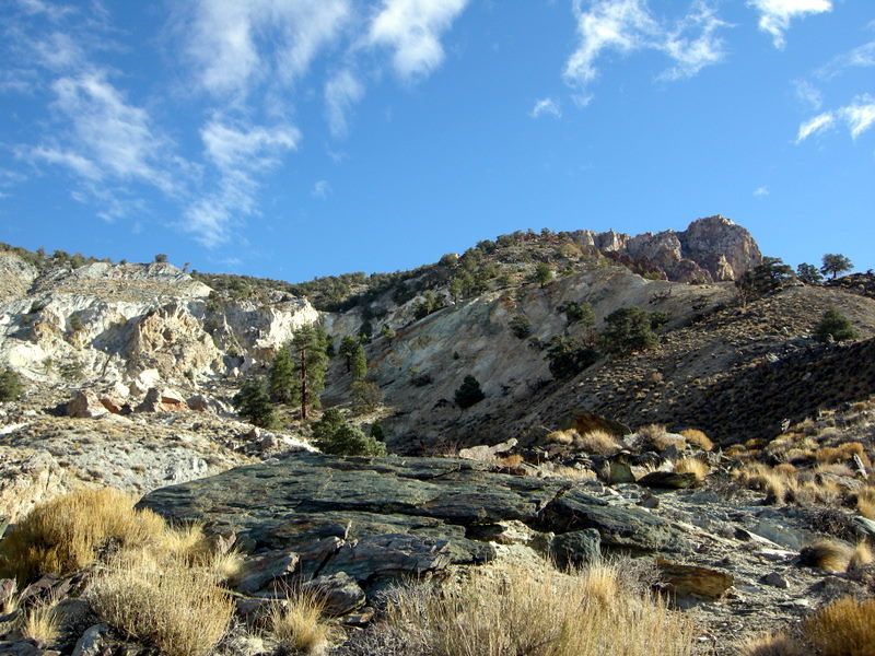 At the end, we leave the vehicles and head toward the camp and mine. The mining area is in that rock at the top right.