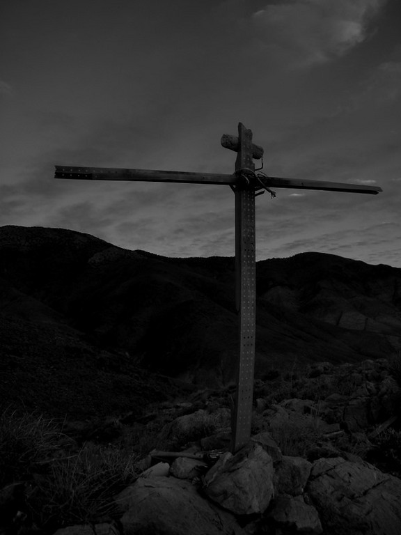 Cross on the hilltop over the crash site, made from plane debris