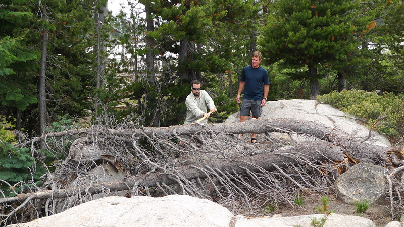 David prepares the firewood. Greg supervises.
