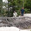 David prepares the firewood. Greg supervises.