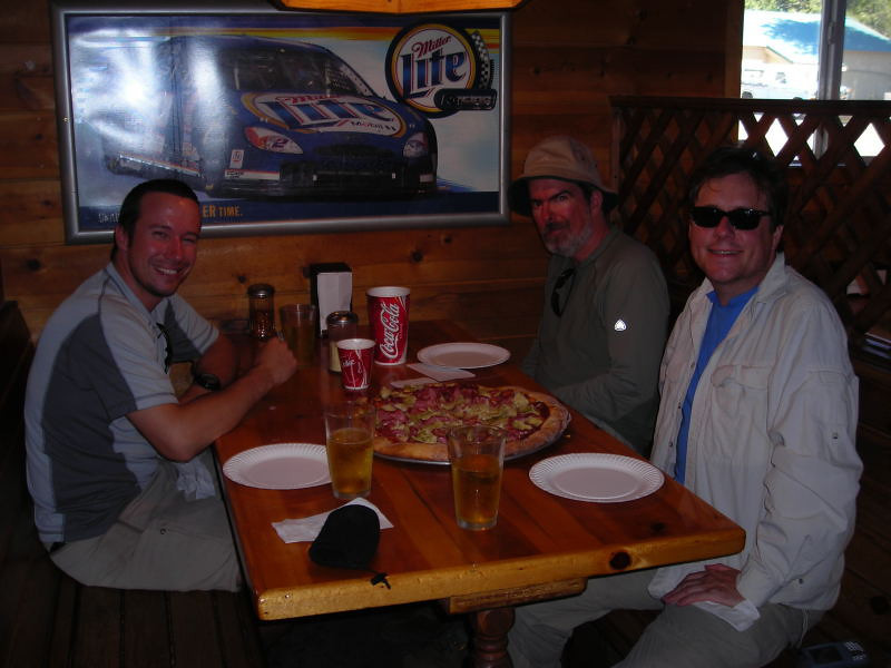Happy Hikers enjoy pizza and beer.