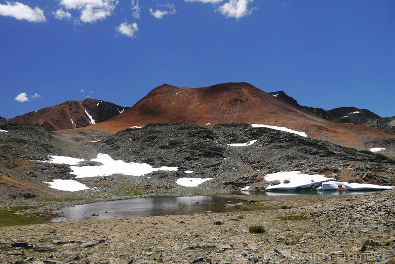 Looking back up at Excelsior (summit is left high point) and the red Hill.