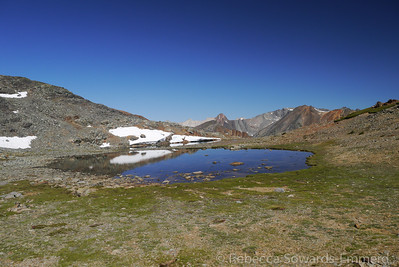 Below the hill, a nice little tarn. And an awesome view.