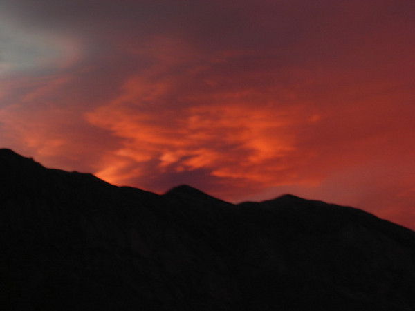 Sierra Sunset<br /> <br /> The setting sun and clouds put on a spectacular show over the Owens Valley.