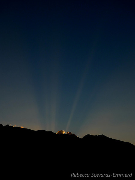 Sunset and shadow of mt whitney in the sunbeams.