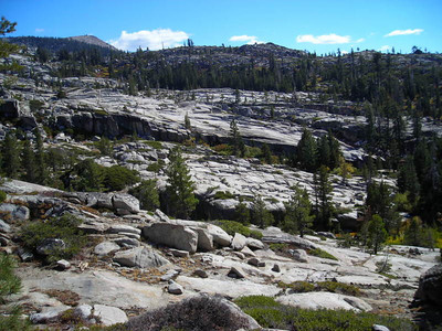 Desolation Wilderness  Typical Desolation sight - glacial polished granite with boulders deposited all willy-nilly.