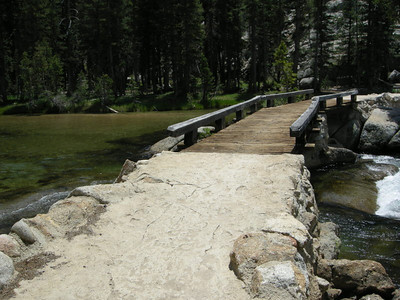 The trail crosses this bridge and the cascades and falls start