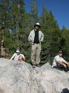 Dave has been fishing his way down the river and caught several  Frank and Jason relax on our camp's nice granite slab