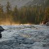 Sunset light on waterfall mist