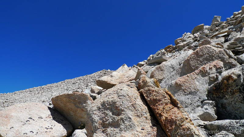 We spy the summit far above us while we navigate through the talus