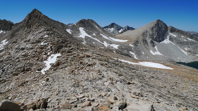 On Italy Pass. Our first view of Seven Gables (distant peak middle-right). Low point on the ridge in front of Seven Gables is Dancing Bear Pass, and the lake on the far right is Jumble Lake. We'll head over Dancing Bear into Bear Lakes Basin. In a couple of days we'll climb Seven Gables.