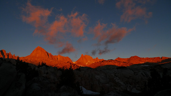 The alpenglow was firey red when I crawled out of my tent in the morning. It was still windy out and there were clouds blowing in just as fast as the day before. My heart sank a bit - I expected it would only get worse and might interfere with our ability to climb Mt Julius Caesar.