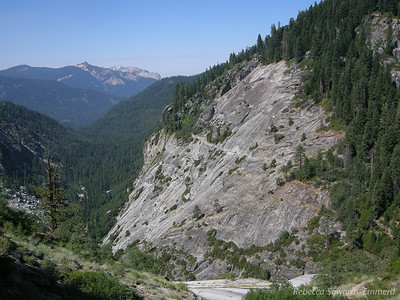 Looking back towards Bearpaw - it sits on the forested hump in the middle of the picture. Notice the trail cut out of granite across the way? Castle peaks in the distance.