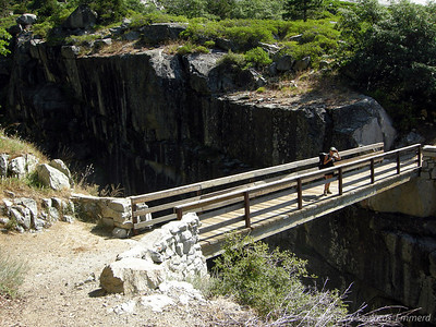 A nice wooden footbridge over the gorge. Violent rocks and river about 100 feet below.