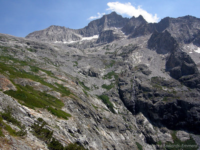 Eagle Scout Peak now towers above us. We can start to see the rock and all of the glacier above Precipice Lake.