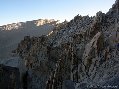 Whitney Summit is in view. See the trail cut through the rocky ridges?