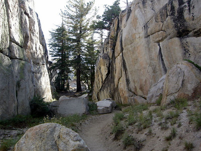 The trail winds betwen rock walls