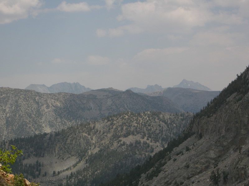The peaks of the Bishop Pass area rise in the distance