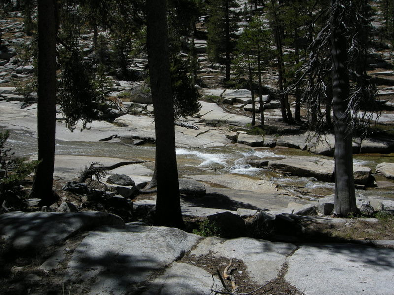 The creek flows over granite