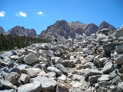 The terrain changes suddenly as the trail passes through a rock field.