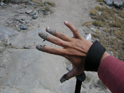 """Tape + Leathery Hiking Hands = """"The Mummy"""", my new trail name.  It was so dry that the skin on my fingertips kept cracking. I found that wrapping them in climbing tape helped a lot...the tape just got dirty quickly."""