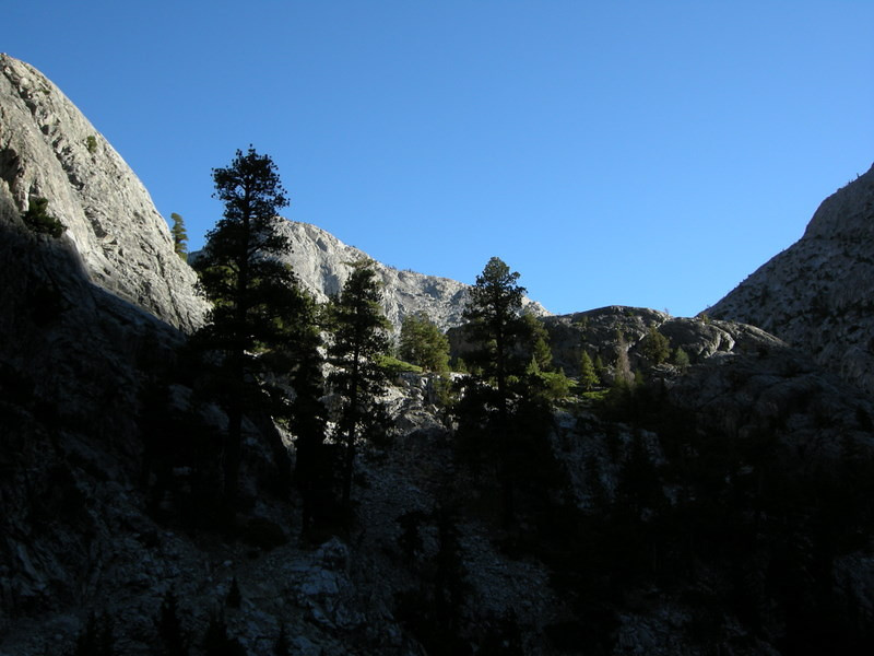 Sun starts to hit the surrounding peaks<br /> <br /> The morning light in the narrow canyon made it difficult to take photos