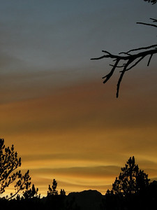 The smoke starts to reflect in shades of yellow and orange