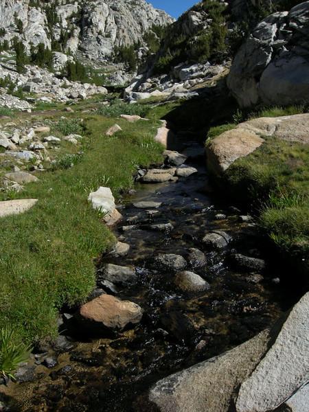 Beautiful green meadows below the pass