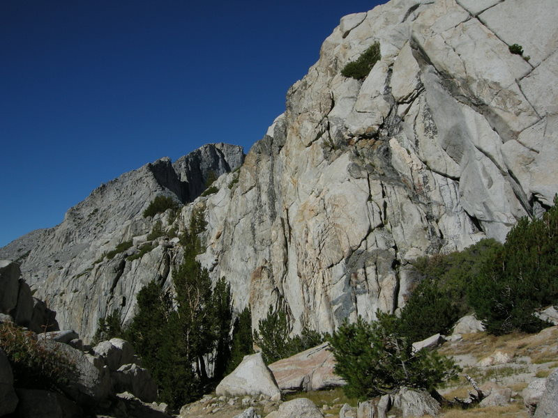 Rock walls line the pass