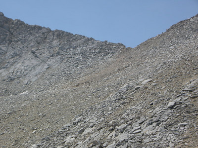 Can you see the nine horses/mules coming down from the pass?