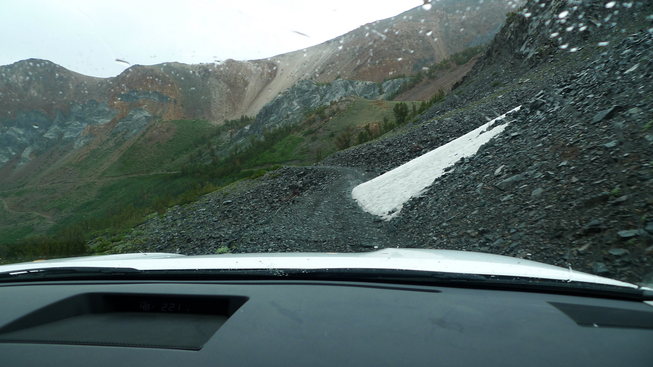 Muddy and rocky shelf road. Wheeeee.
