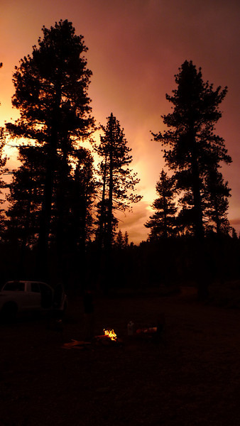 Campfire and clearing stormy skies.