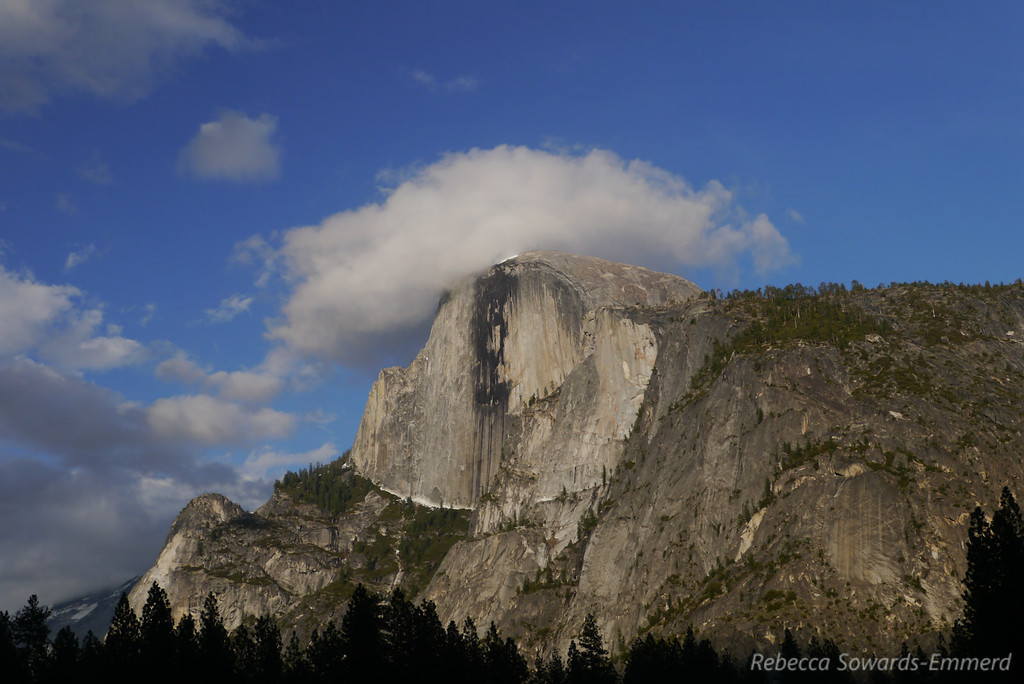 Half Dome with a cloudy hat. Clouds Rest is in the cloud behind it.