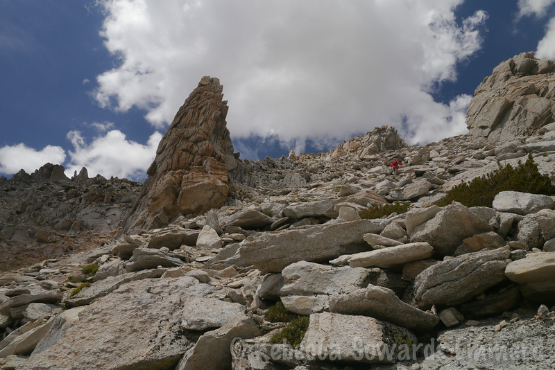 Next to the gendarme. We climb a bit higher before traversing to the left. Summit is above Deb (red jacket)