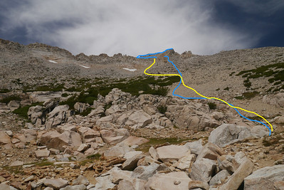 Blue line is the route up, yellow is down. We head up to the right of a large gendarme, then traverse over to a platform from which we can scramble to the summit. On our descent, yellow, we bombed down the sandy chute to the left of the gendarme.