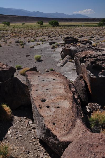 Morteros in a rock below