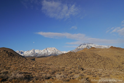 View from my sleeping bag in the morning. The moon is above Mt Humpreys. To the right of Humphreys, the flat topped peak is Basin, and the big one on the right is Mt Tom. We climbed Basin and Tom last September.