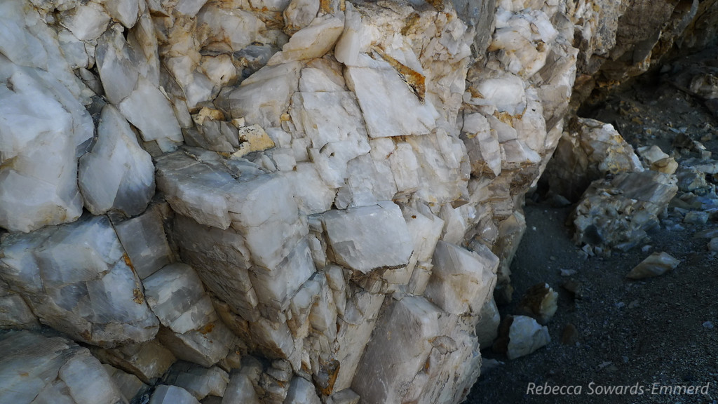 There is an old shovel next to this wall of calcite.