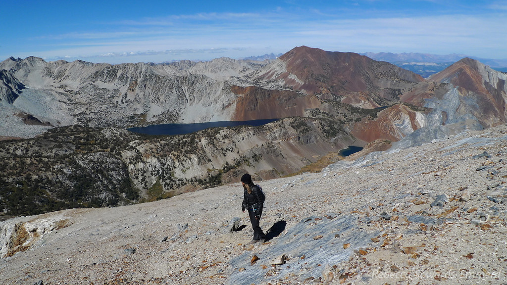 Heading up the loose slope to the summit. Lake Dorothy in the middle, and Mildred Lake (camp) to the right.