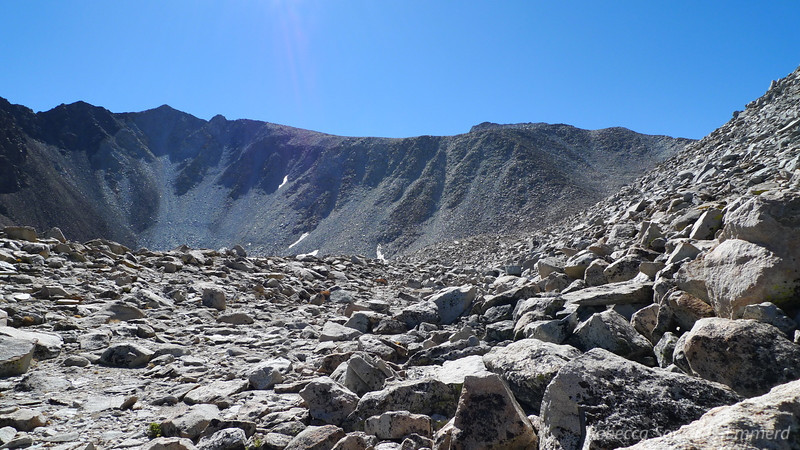 At the saddle. The next part of the route is out of view but I hope it goes. Contour around the high point from here.