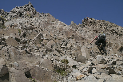Climbing the feature-filled face of Morrison. Class 2 most of the way, with lots of careful route finding.