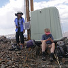 Cori and Robin on the summit with the weather station (or squat outhouse?)