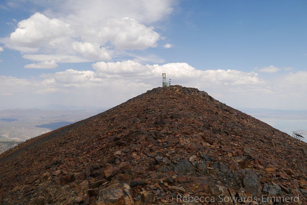 I walked down the west ridge to check out the view. This is looking back on the summit.