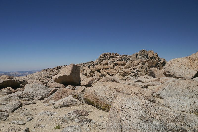 On the summit plateau, looking towards the N summit. I head to the S, named summit.