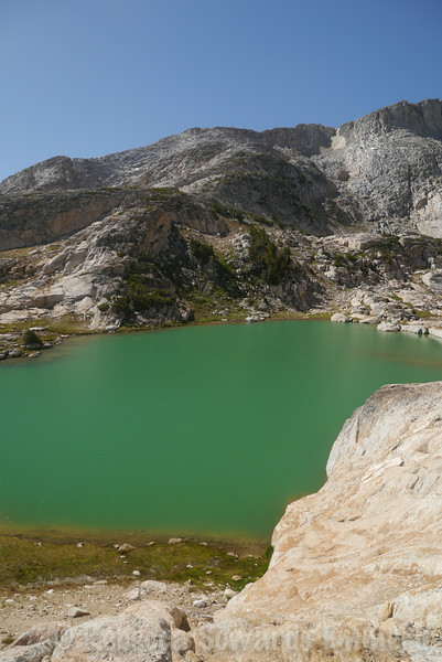 Getting around the first lake requires a bit of scrambling up and around rocky outcrops.