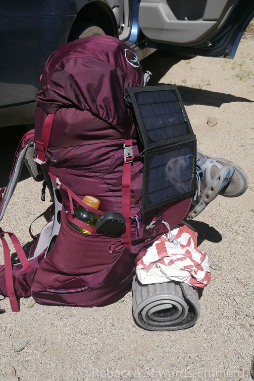 Not the most organized, but here's what my Osprey Aura looks like loaded up for 9 days. The Goal Zero Nomad 7 solar panel was secured to my pack using some NiteIze gear ties and it worked perfectly!
