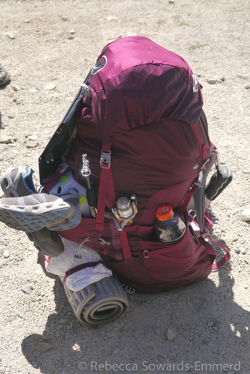 From the other side. Including: GPS devices, camp shoes, sit pad, tyvek sheet, fishing pole, and helmet.