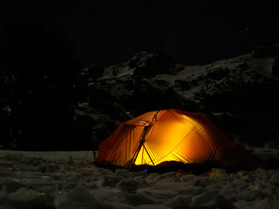 Nightime at Camp  Our tent with the peaks illuminated by moonglow